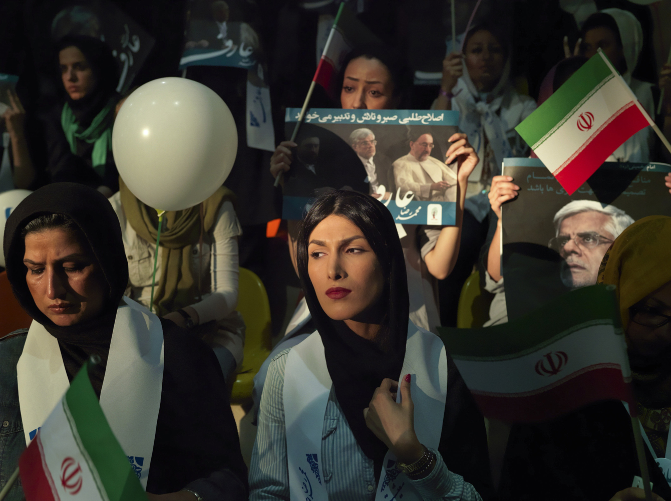 June 10, 2013. Yasaman Karimi, 23, a young supporter of Dr. Aref who is one of two reformists out of the eight candidates in the Iranian election, gathers near Hejab stadium in the center of Tehran.