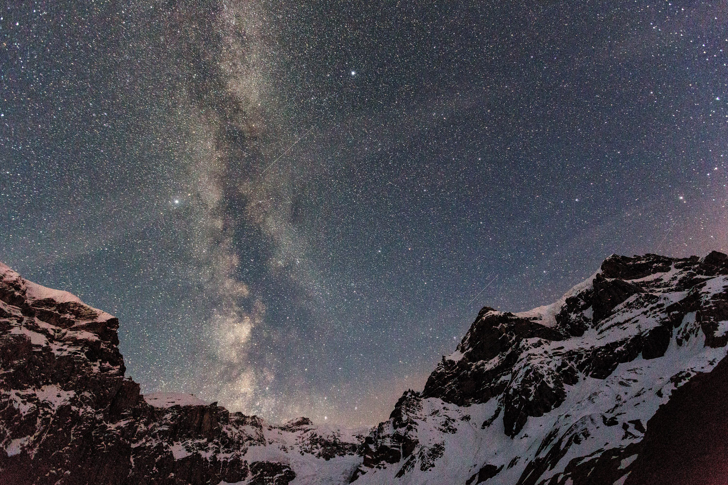 June 13, 2013. The Milky Way is seen between the Biferstock, the Piz Urlaun and the Toedi mountain above Linthal, Switzerland.