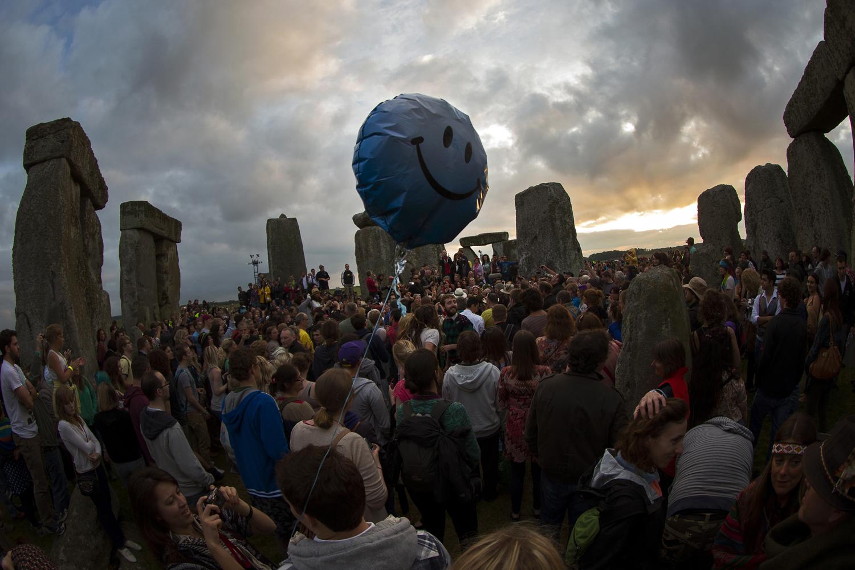 June 20, 2013. Revelers gather to celebrate the Summer Solstice within the circle of standing stones at Stonehenge, near Salisbury, U.K.