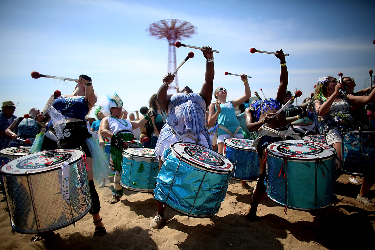 June 22, 2013. Musicians perform on the beach at the 2013 Mermaid Parade at Coney Island in the Brooklyn borough of New York City.