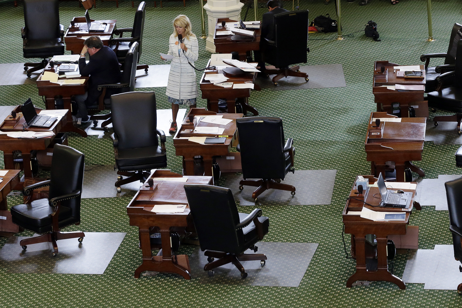 June 25, 2013. Sen. Wendy Davis, D-Fort Worth, stands on a near empty senate floor as she filibusters in an effort to kill an abortion bill in Austin, Tx.