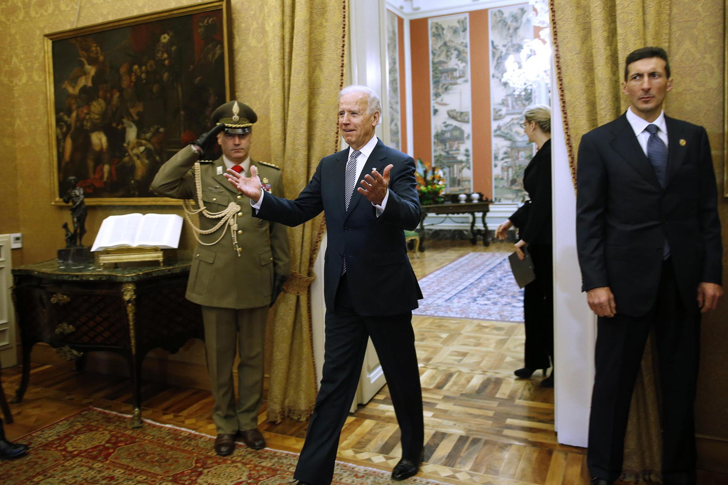 March 18, 2013. U.S. Vice President Joe Biden gestures while entering to meet Italy's President Giorgio Napolitano at the Quirinale palace in Rome, Italy.