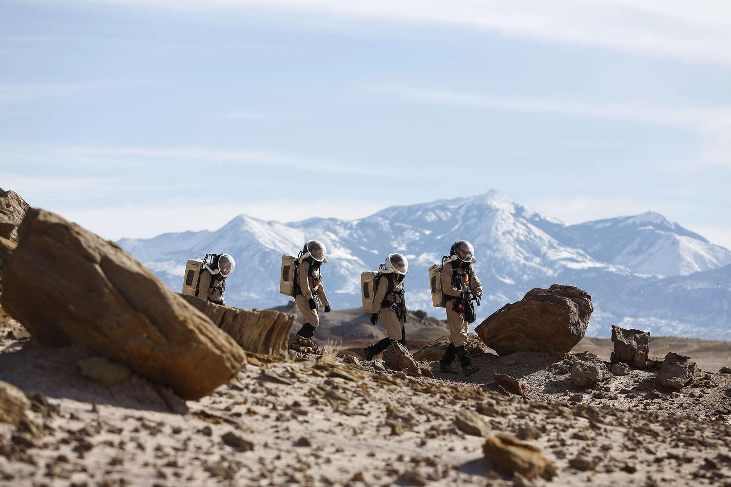 March 2, 2013. Members of Crew 125 EuroMoonMars B mission venture out in their simulated spacesuits to collect geologic samples to be studied at the Mars Desert Research Station (MDRS) outside Hanksville in the Utah desert.