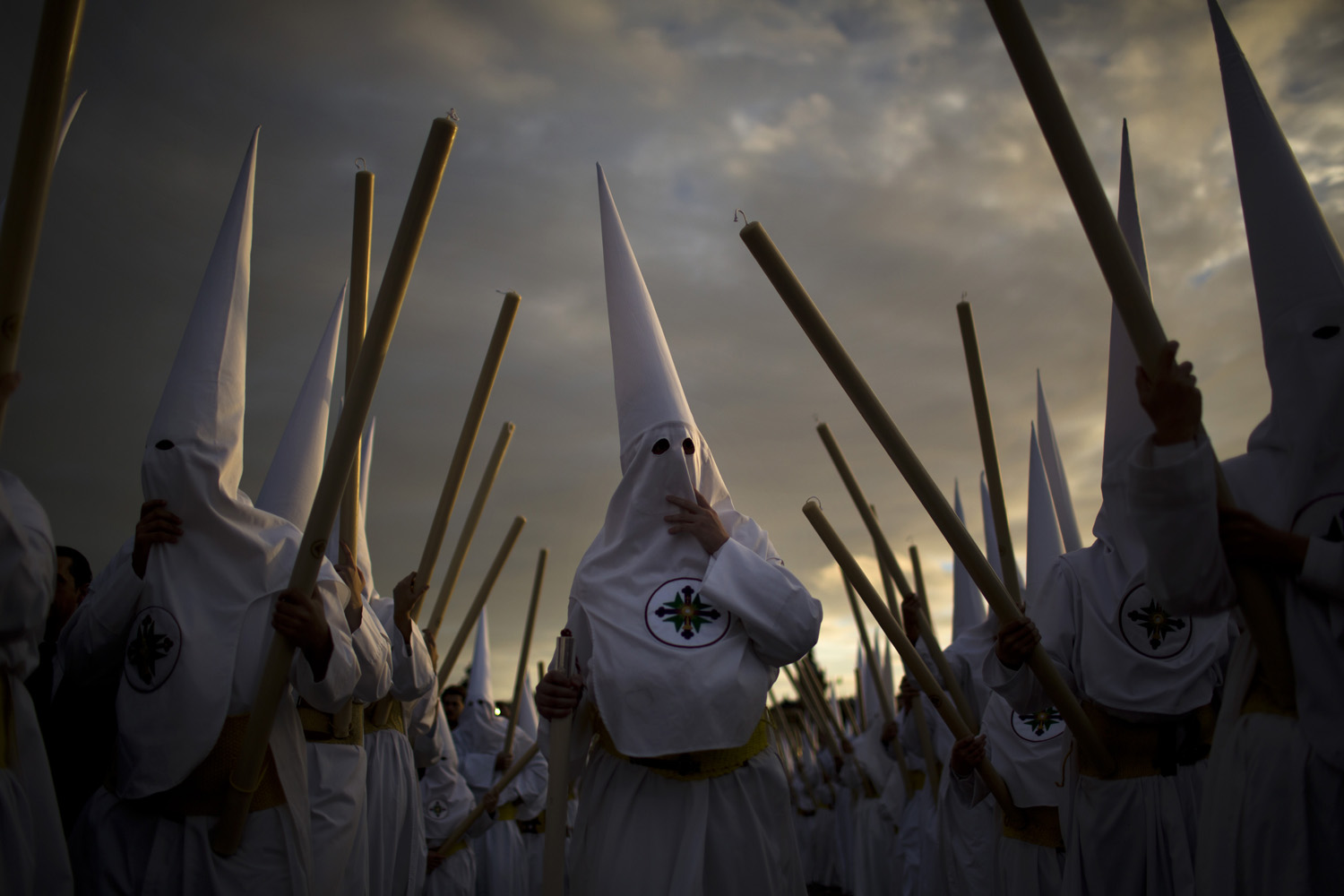 March 25, 2013. Penitents from  San Gonzalo  brotherhood take part in a procession in Seville, Spain.