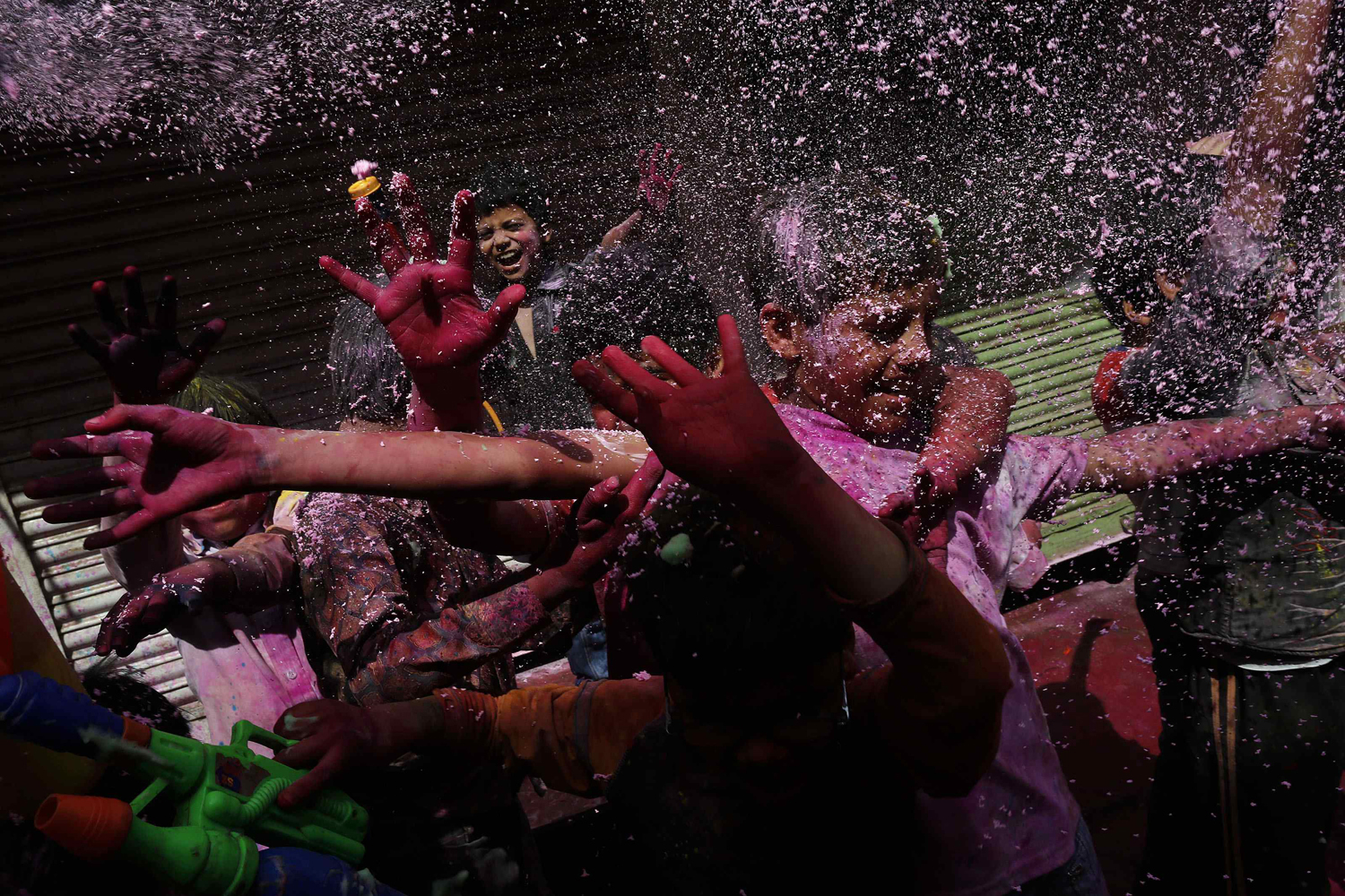 March 26, 2013. Boys spray coloured foam during Holi celebrations at a lane near the Bankey Bihari temple in Vrindavan, in the northern Indian state of Uttar Pradesh.