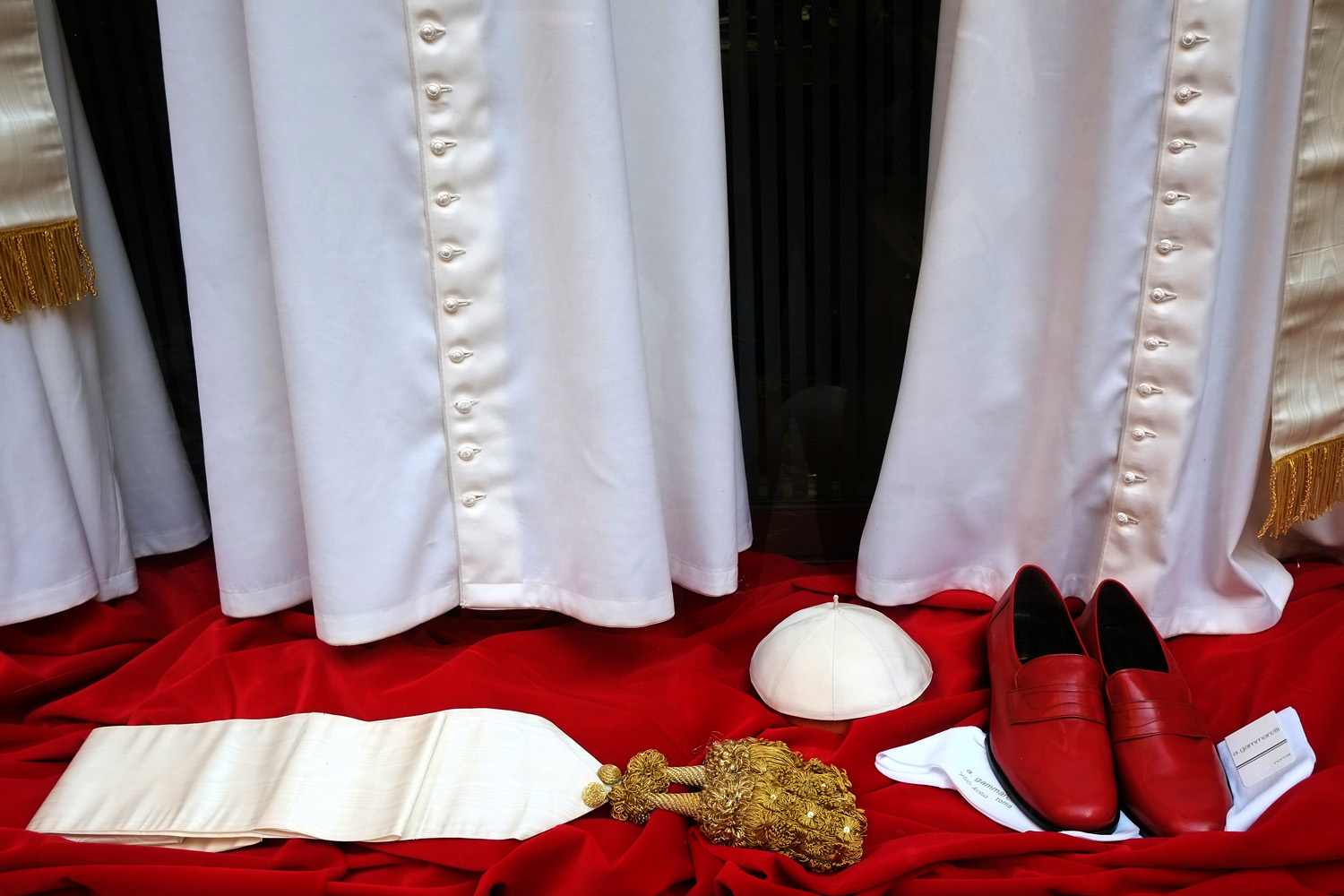 March 4, 2013. Vestments for the new Pope to be elected are displayed in the window of Italian ecclesiastical tailor Gammarelli in Rome.