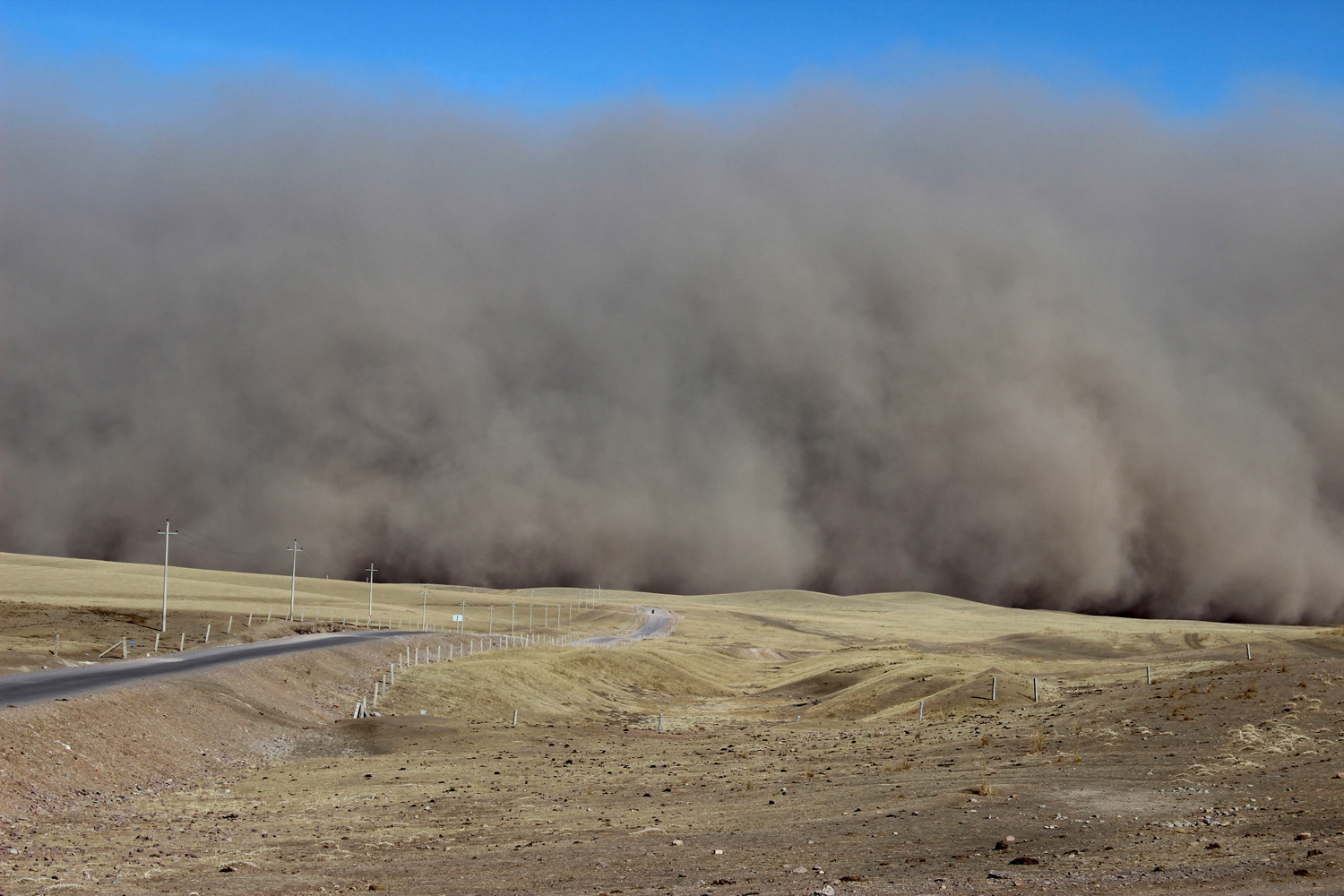 March 5, 2013. A sandstorm hits the town of Shandan Horse Ranch in Zhangye, northwest China's Gansu province.
