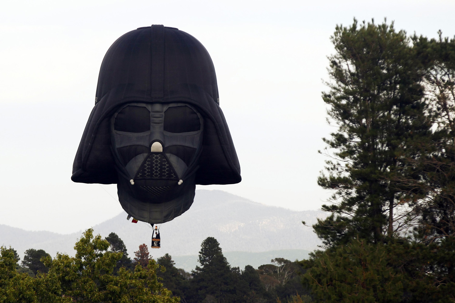 March 9, 2013. A hot air balloon shaped like Darth Vader's head lands after a sunrise flight in Canberra, Australia.