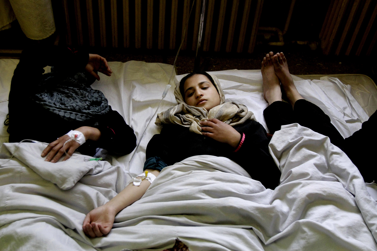 May 1, 2013. Afghan school girls receive treatment at a hospital in Kabul.