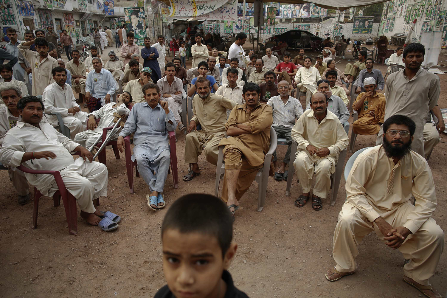 May 11, 2013. Supporters of the Pakistan Muslim League, Nawaz, watch news on a television screen at the party's election headquarters after polling stations closed in Lahore.
