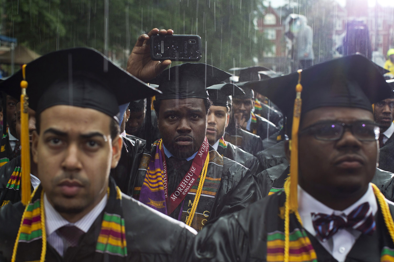May 19, 2013. Graduates listen under heavy rain to President Barack Obama as he delivers the Morehouse College 129th Commencement ceremony address in Atlanta.