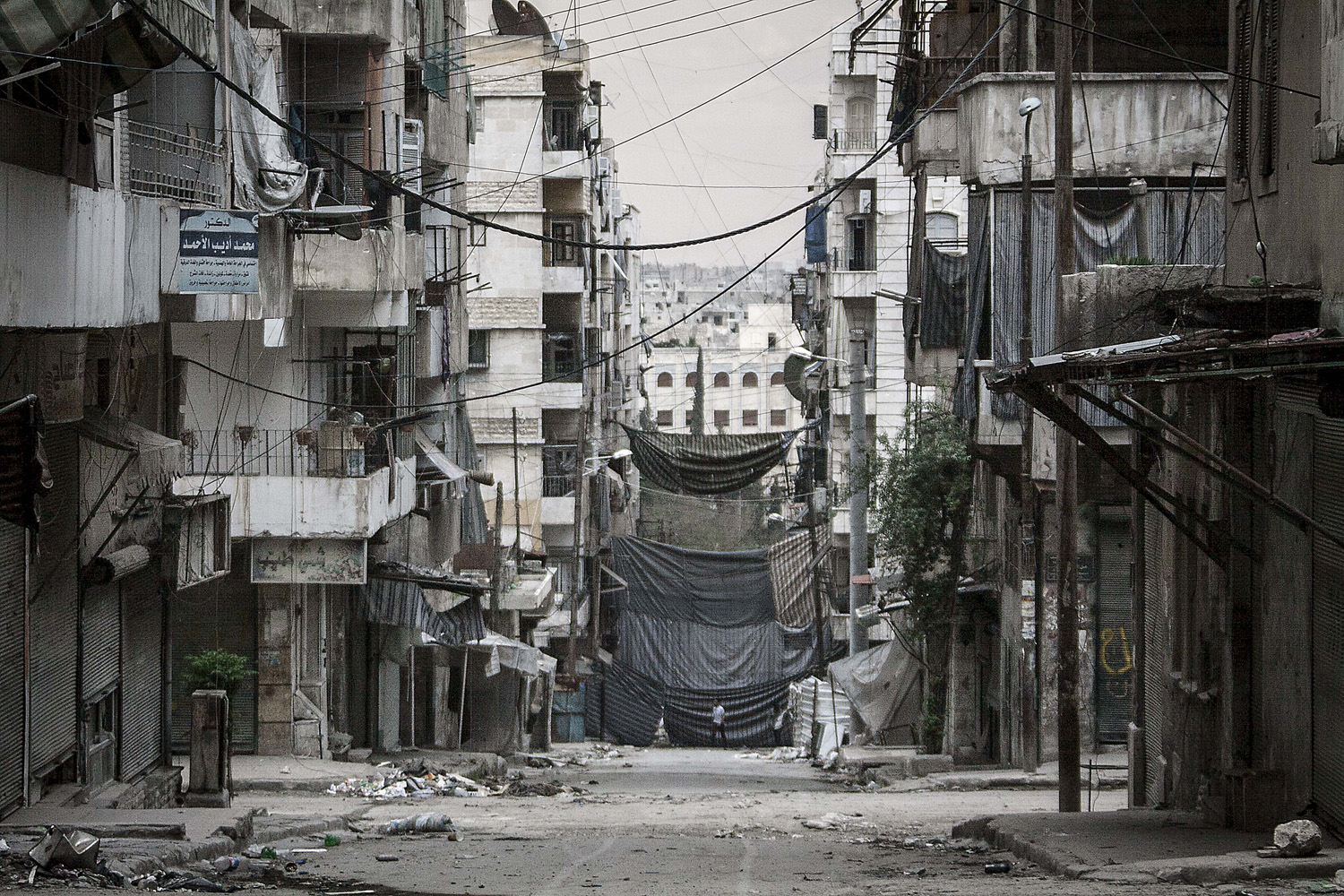 May 3, 2013. Veils used as cover from sniper fire are seen at Sheikh Maksoud front line, a majority-Kurdish neighborhood  in Syria.