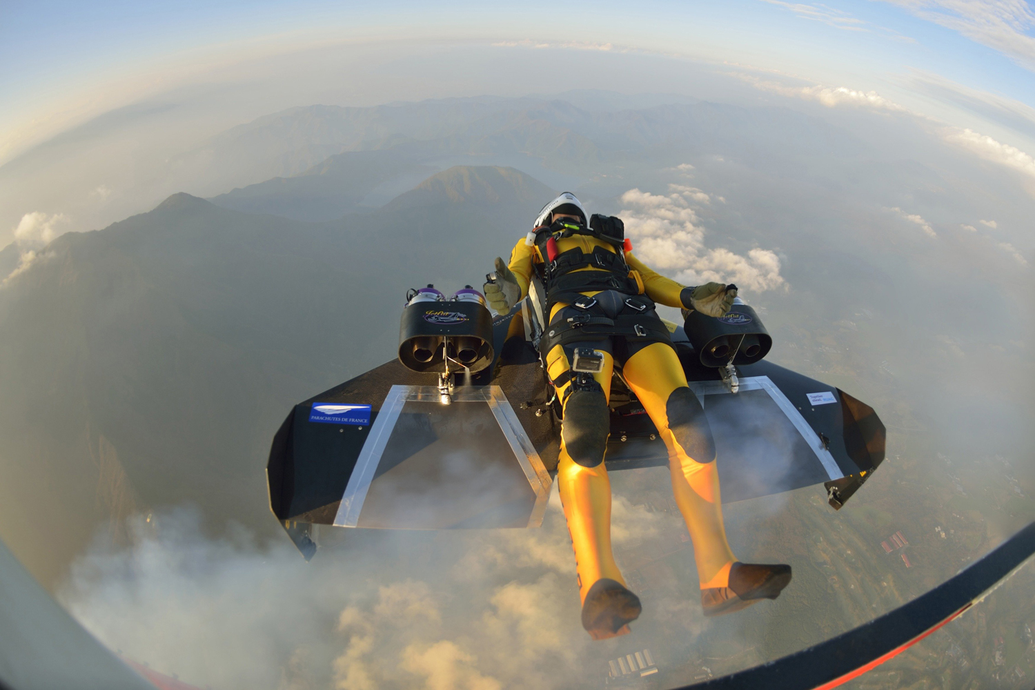 Nov. 1, 2013. Yves Rossy, known as the Jetman, drops from a helicopter to fly near Mount Fuji in this handout photograph released by Breitling SA.