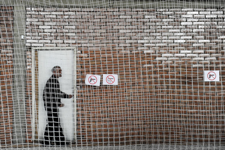 Nov. 3, 2013. A Kosovo Albanian man leaves a polling station in Pristina.