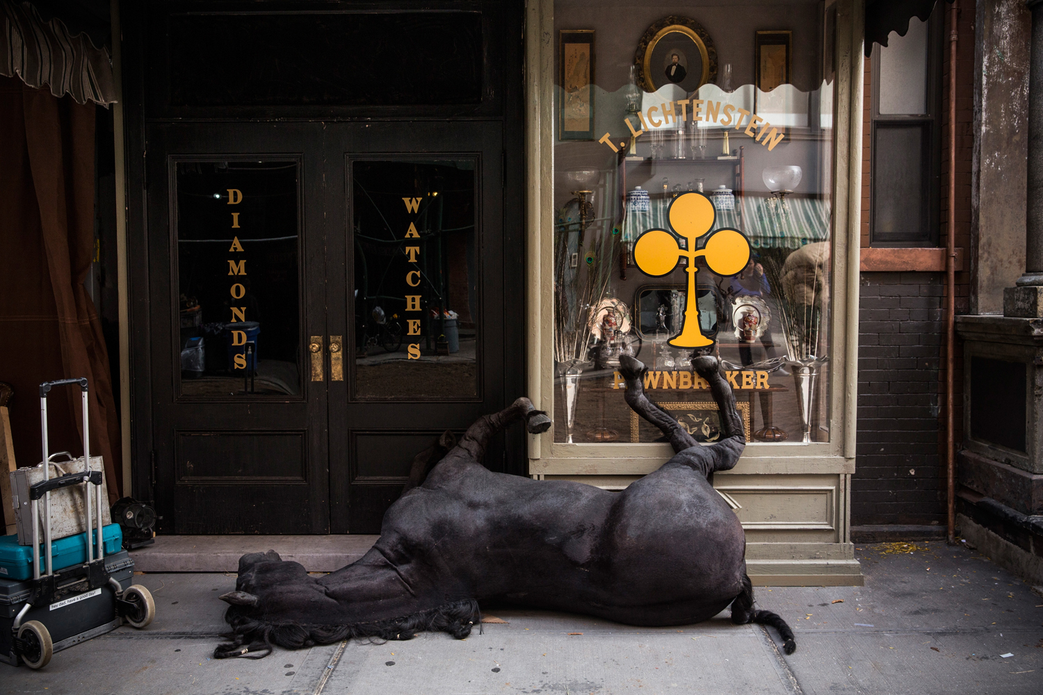 Nov. 6, 2013. A fake dead horse is seen on set for a television show being filmed in the Lower East Side neighborhood of the Manhattan borough of New York City.