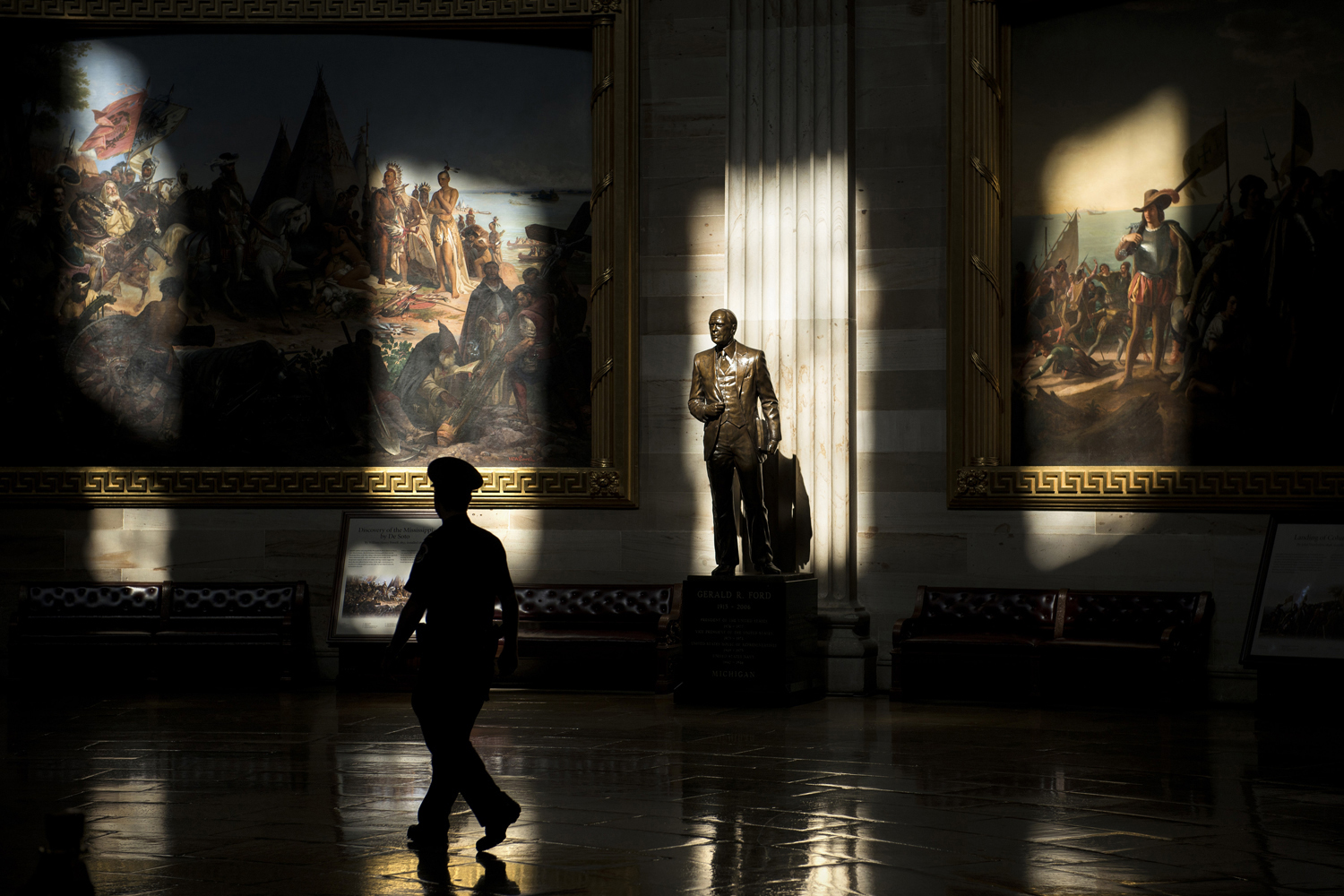 Oct. 1, 2013. A U.S. Capitol Police Officer walks past a statue of Gerald Ford, who was US president during the 1976 shutdown of the federal government, in the Rotunda while the building was closed to tours on Capitol Hill in Washington.