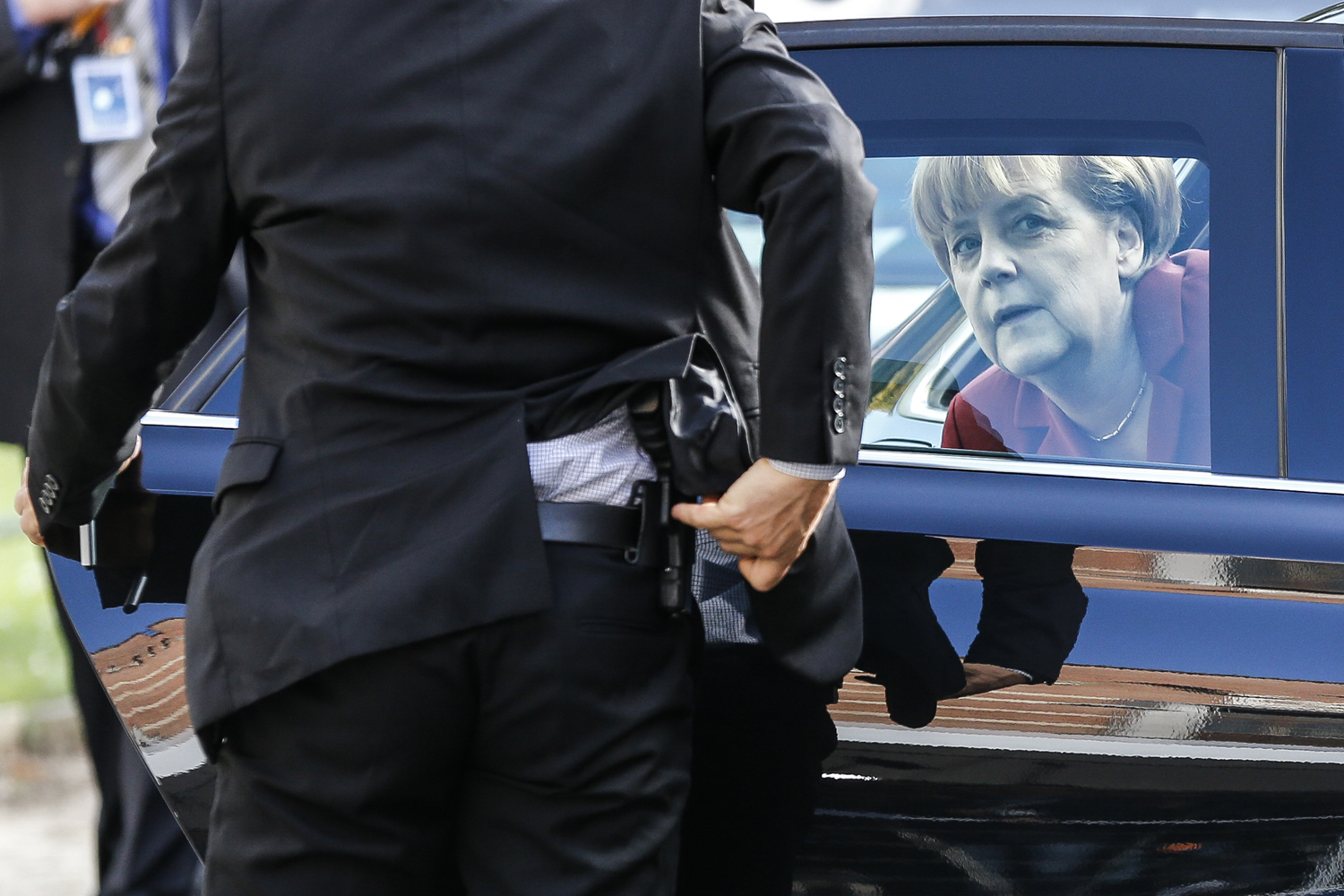 Oct. 24, 2013. German Chancellor Angela Merkel (R) arrives for a meeting of the European People's Party (EPP) ahead of a European Union summit at Meise, outside Brussels, Belgium.