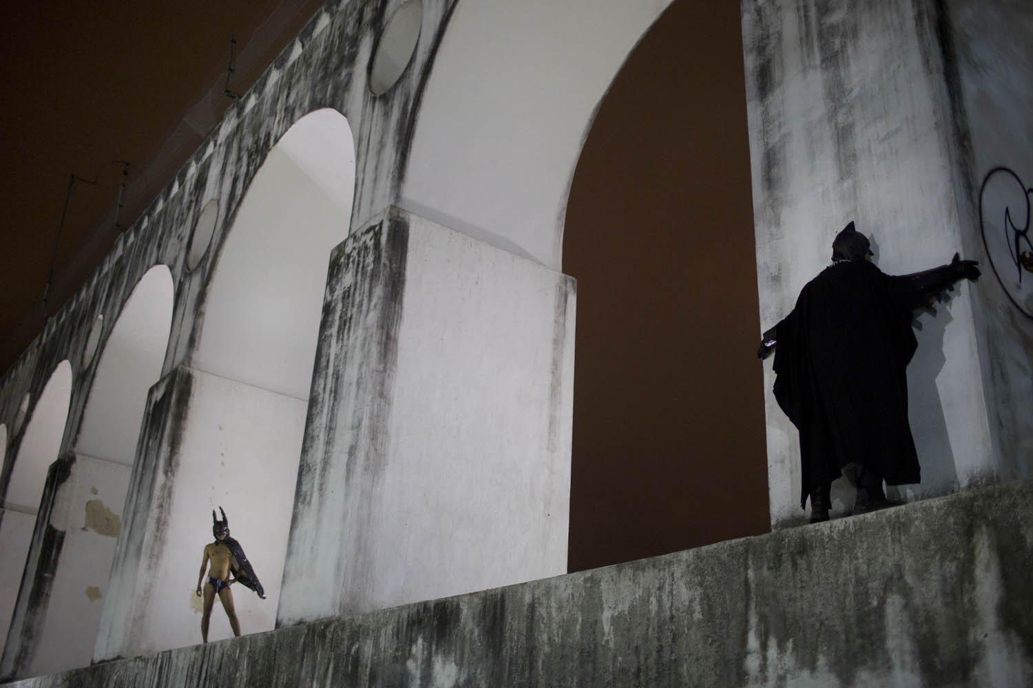 Oct. 31, 2013. Protesters wearing Batman costumes stand over the Carioca Aqueduct, also know as Arcos da Lapa, during a demonstration in Rio de Janeiro, Brazil.