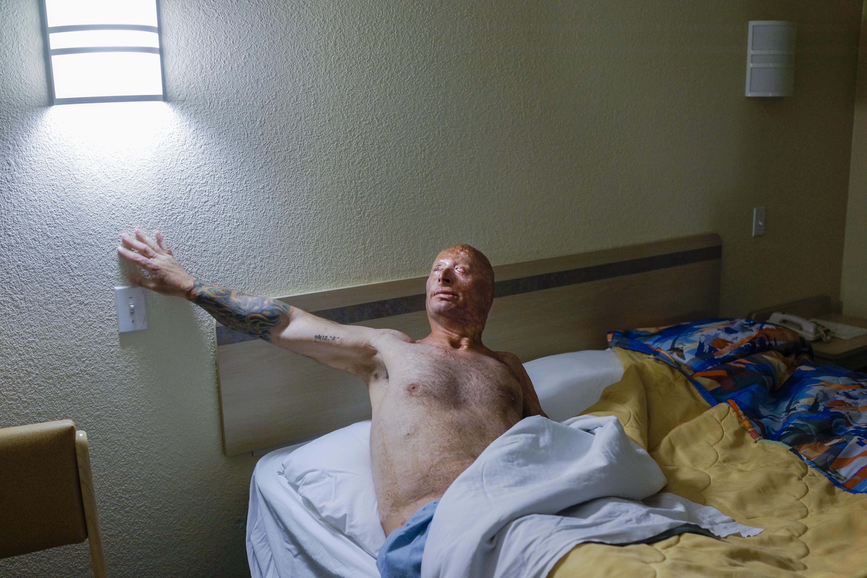 Bobby goes to sleep at a Motel 6. Humble, Texas, 2013.