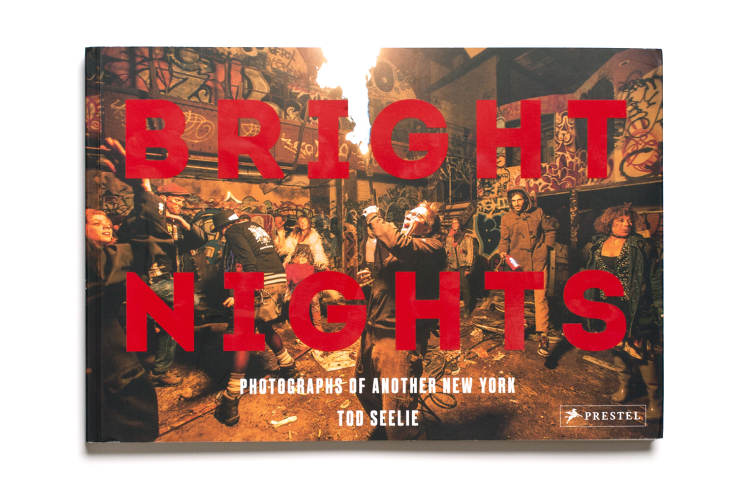 Bright Nights: Photographs of Another New York by Tod Seelie, published by Prestel, selected by Eugene Reznik, writer and photographer, contributor to LightBox.