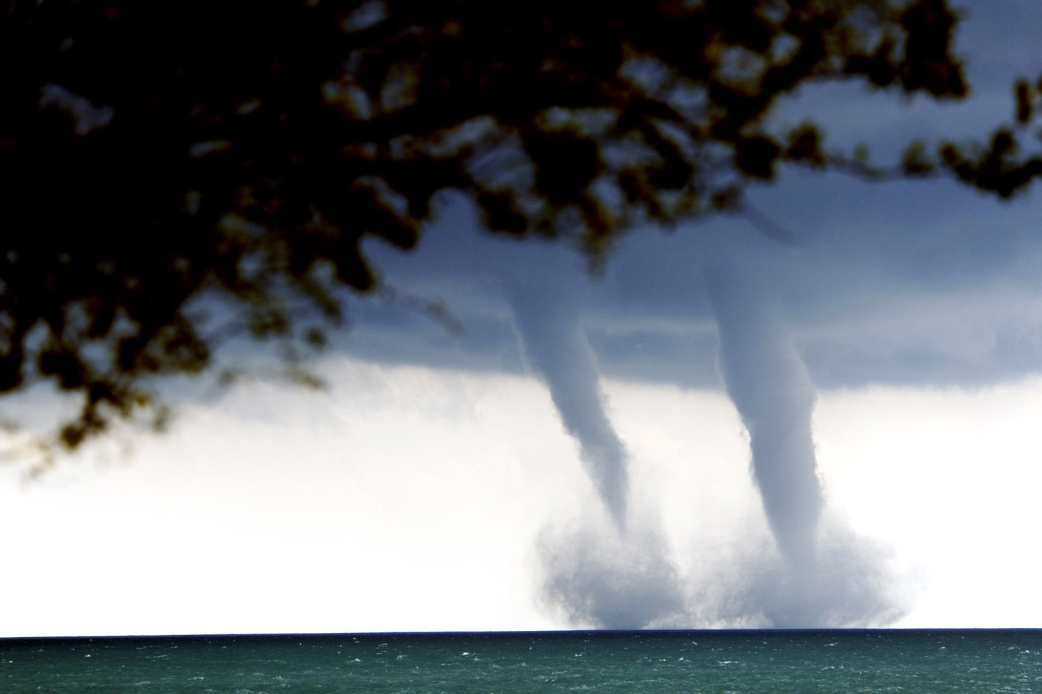 Sept. 12, 2013. A pair of water spouts form on Lake Michigan southeast of Kenosha, Wis.