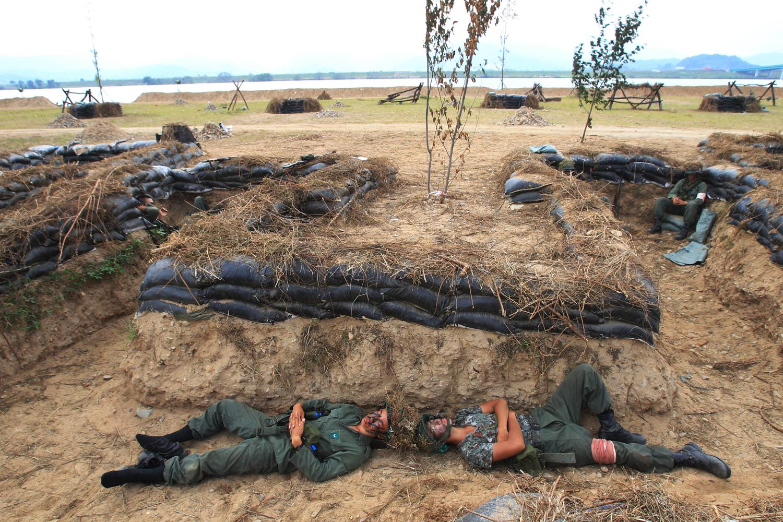Sept. 13, 2013. South Korean army soldiers take a rest before they reenact the Battle of the Naktong Bulge near the Waegwan railway bridge in Waegwan, South Korea.