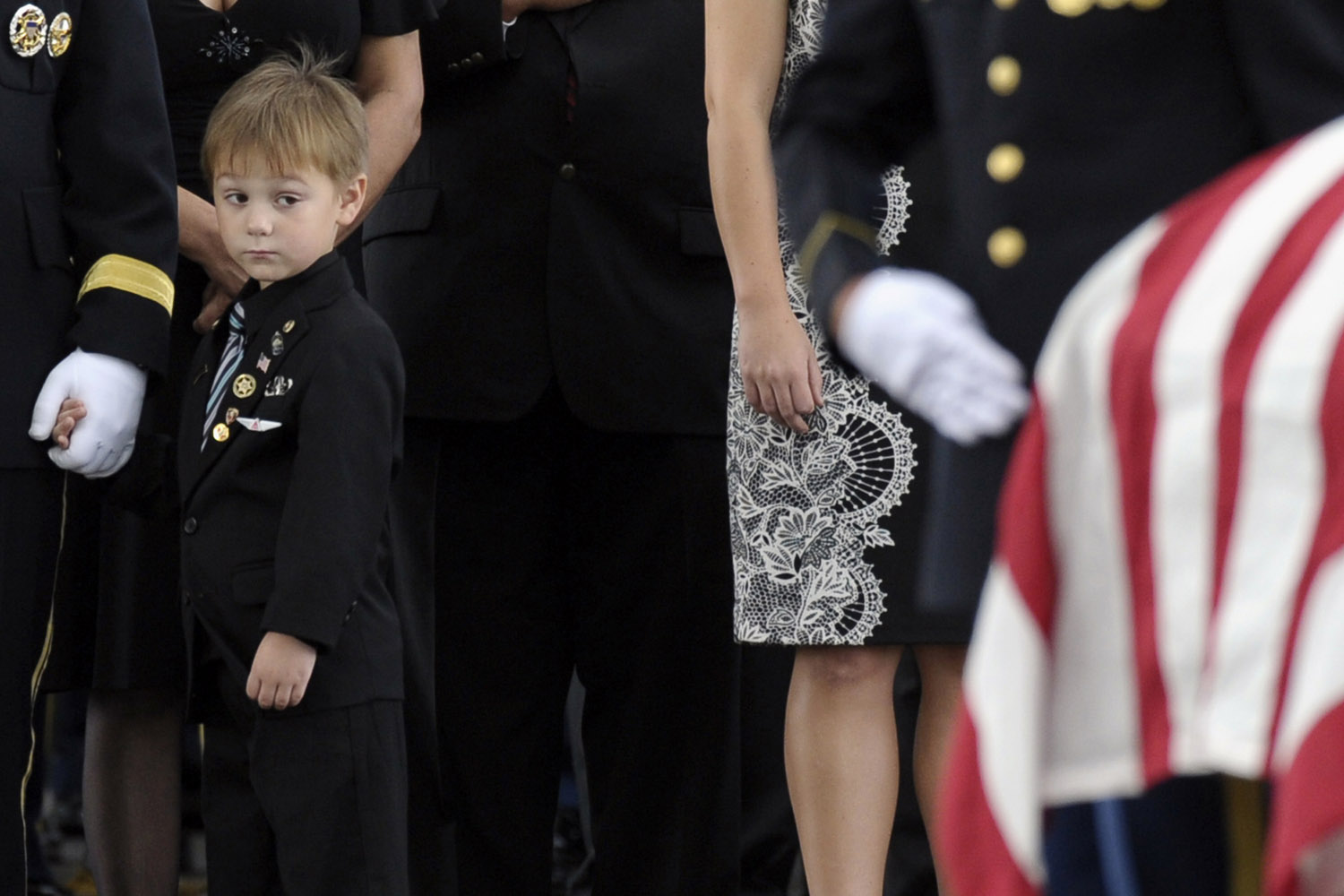 Sept. 27, 2013. Kaden Bowden, son of U.S. Army Staff Sgt. Joshua J. Bowden, looks at the casket for his father during burial services for Staff Sgt. Bowden at Arlington National Cemetery in Arlington, Va.