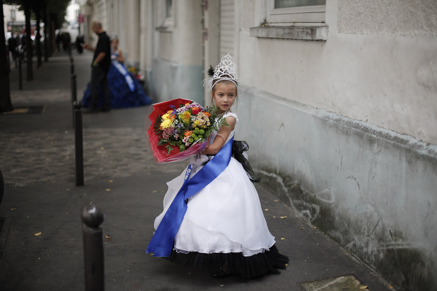 Sept. 28, 2013. Lou Hamrani, 6, walks in the street after attending the Mini Miss model beauty contest in Paris, France.