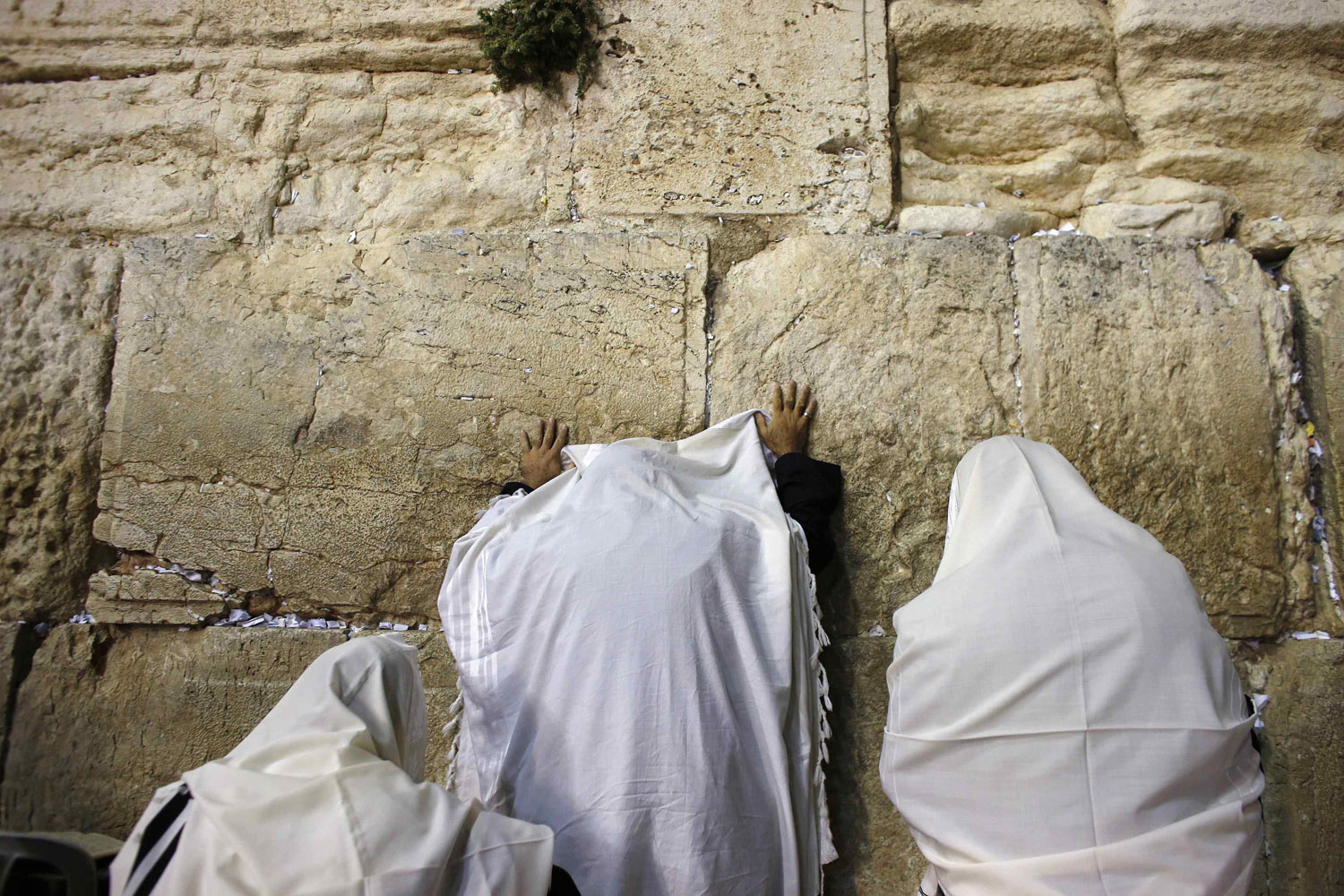 Sept. 3, 2013. Jewish worshippers pray at the Western Wall, Judaism's holiest prayer site, in Jerusalem's Old City.