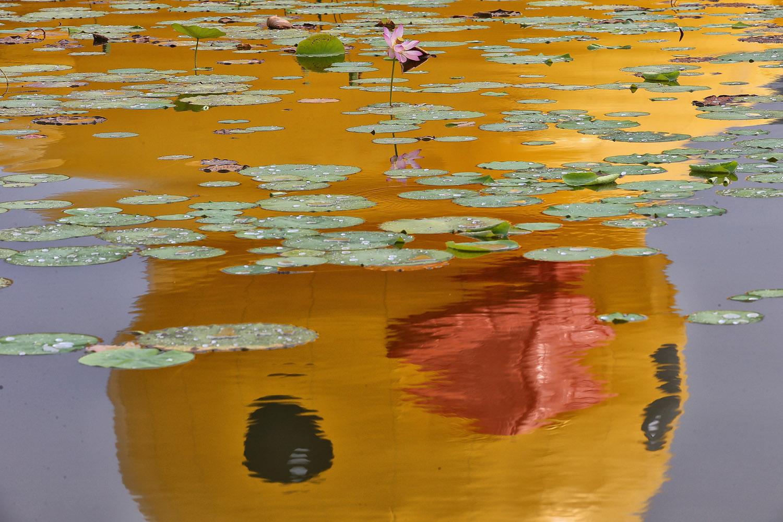 Sept. 6, 2013. A reflection of the rubber duck designed by Dutch artist Florentijn Hofman on the water at Beijing Garden Expo Park in Beijing.