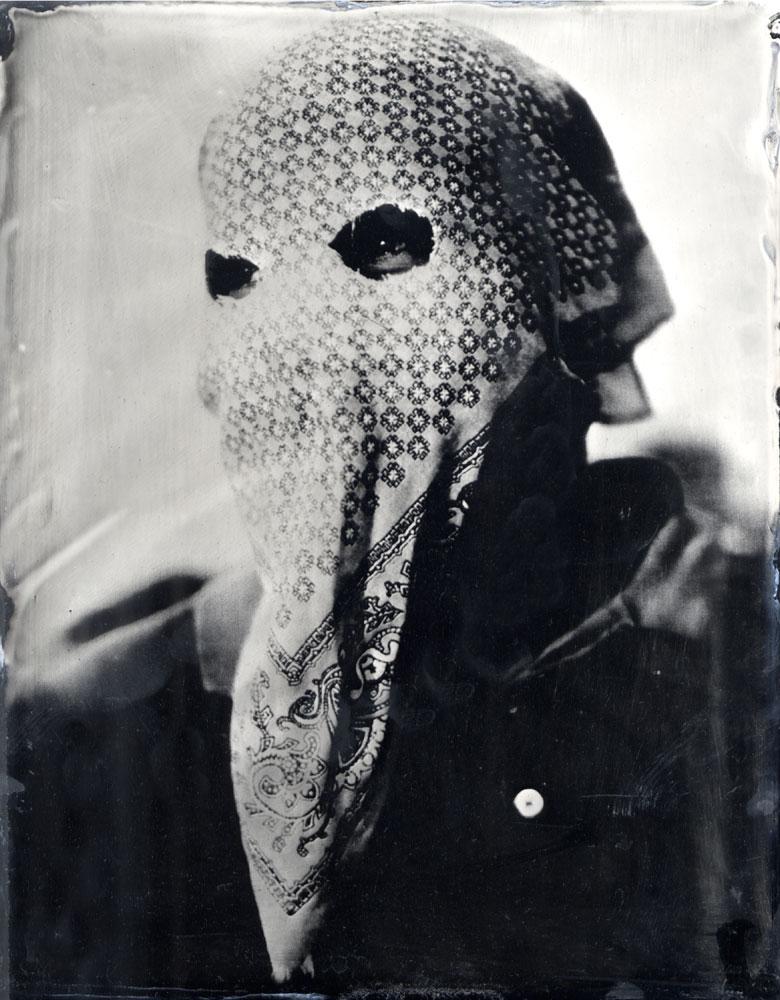 A masked member of the 'auto defensa' committee in Ayutla de los Libres, a small pueblo in the La Costa Chica region of Guerrero state, Mexico. Ambrotype glass plate, 2013.