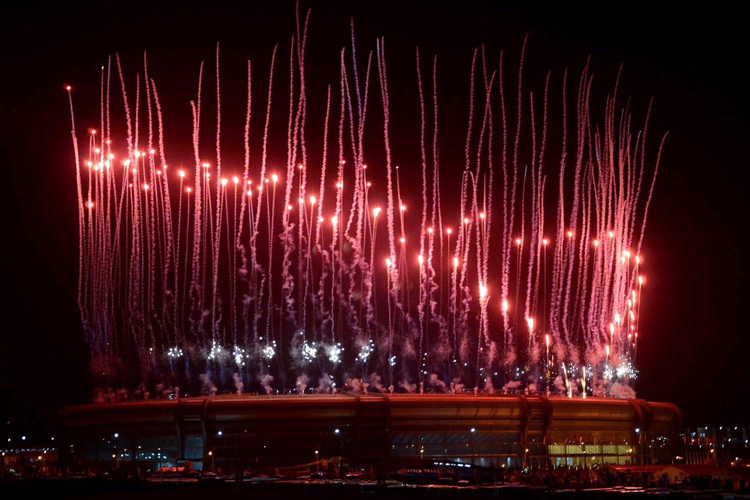 Dec. 11, 2013. In this photo provided by the Myanmar News Agency, fireworks illuminate the sky above the Wunna Theikdi Stadium during the opening ceremony of the 27th South East Asia (SEA) Games in Naypyitaw, Myanmar.