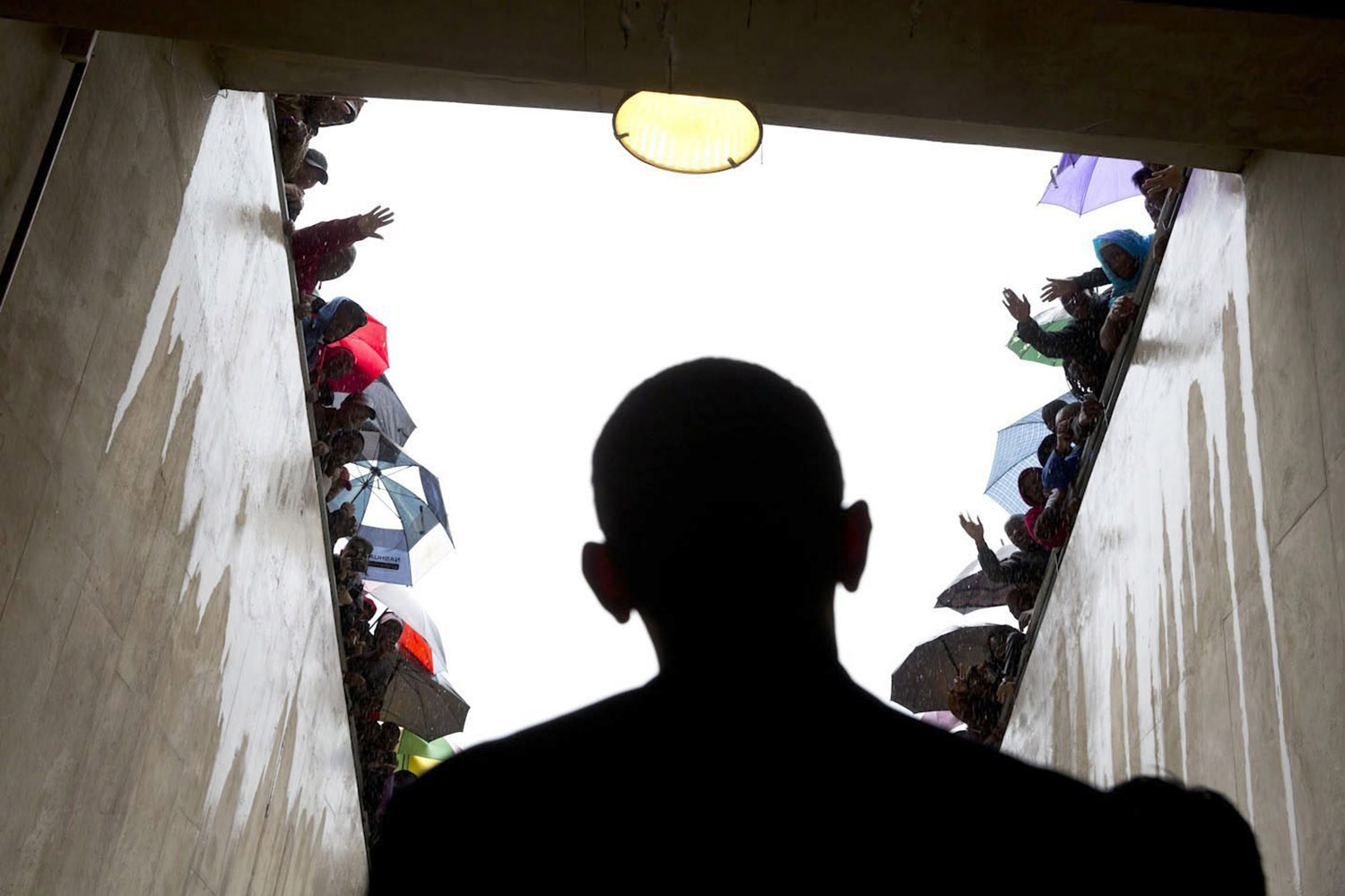 Dec. 10, 2013. A photo provided by the White House on Dec. 12, 2013 shows South Africans cheering as U.S. President Obama walks through a tunnel at the soccer stadium before taking the stage to speak at the memorial service for late South African president Nelson Mandela at FNB Stadium in Johannesburg, South Africa.