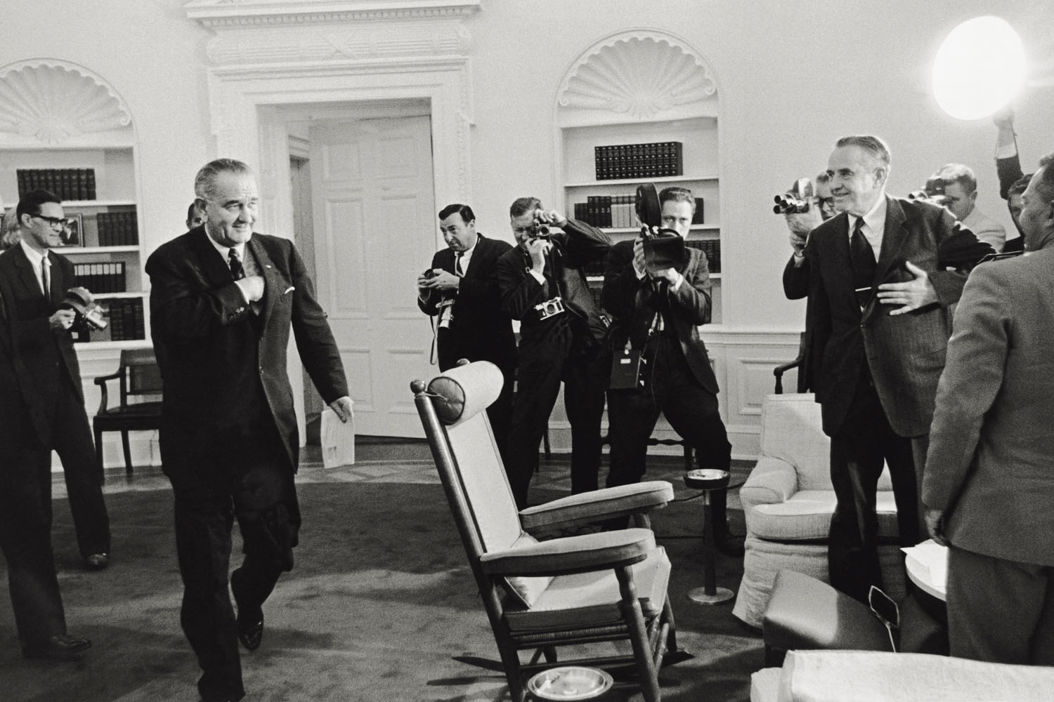 President Johnson is photographed during a meeting with Under Secretary of State William Averell Harriman in the White House.