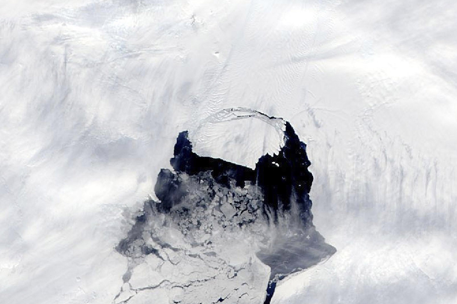 Nov. 10, 2013. In this photo provided by NASA, an iceberg which was part of the Pine Island Glacier is shown separating from the Antarctica continent.