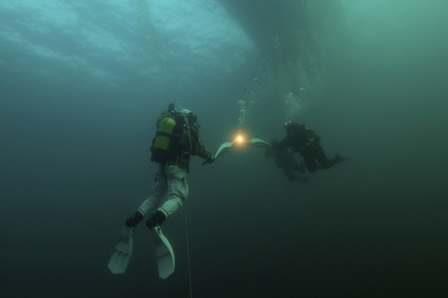 Undated. In this photo provided by the Organizing Committee Sochi 2014, diving torchbearers are seen during the Sochi 2014 Winter Olympic torch relay underwater in Lake Baikal, Russia.