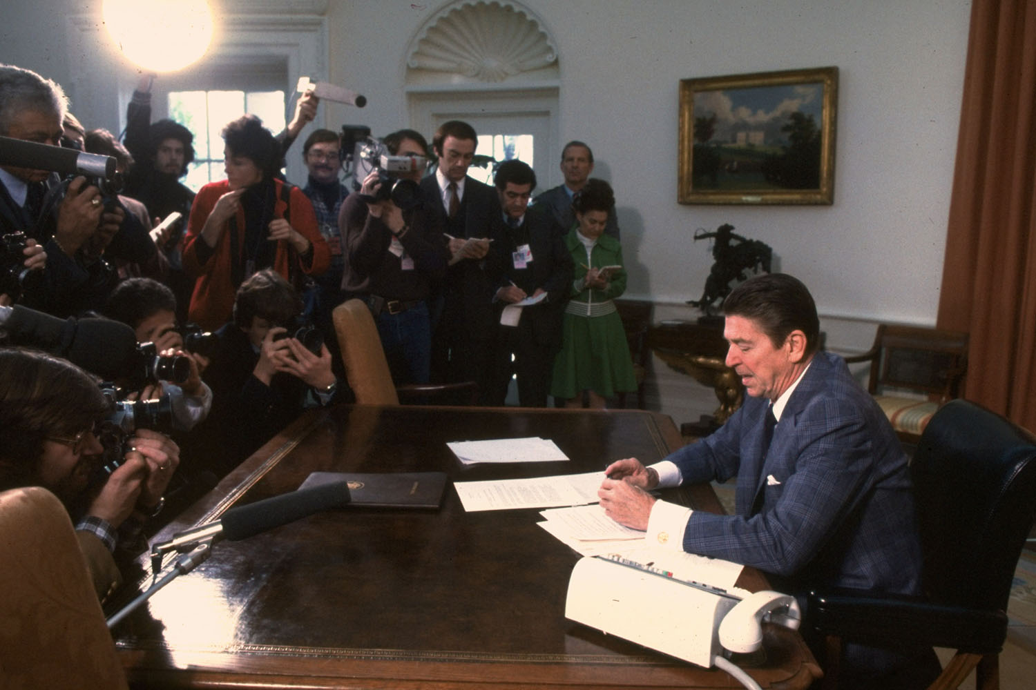 President Ronald Reagan in front of reporters in the Oval Office for the first time as President, 1981.
