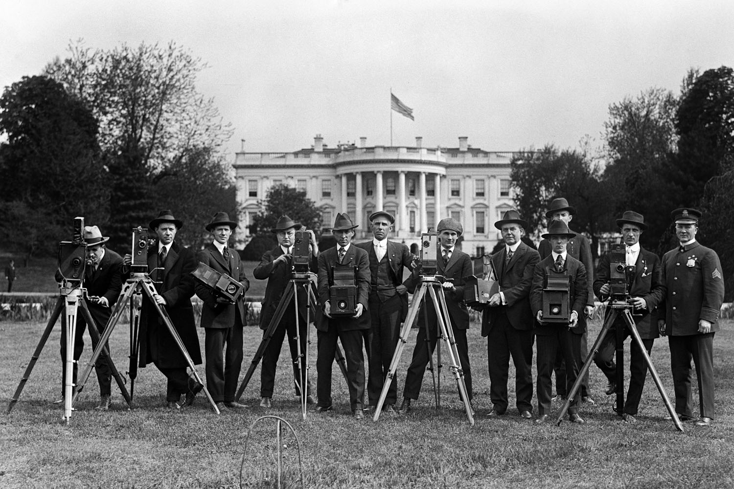 Photographers pose at the White House during the Woodrow Wilson administration in 1918.