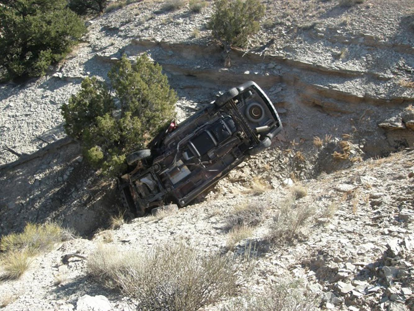 Oct. 18, 2013. This photo released by the Utah Highway Patrol shows a vehicle in a ravine where David Welch was found in eastern Utah.