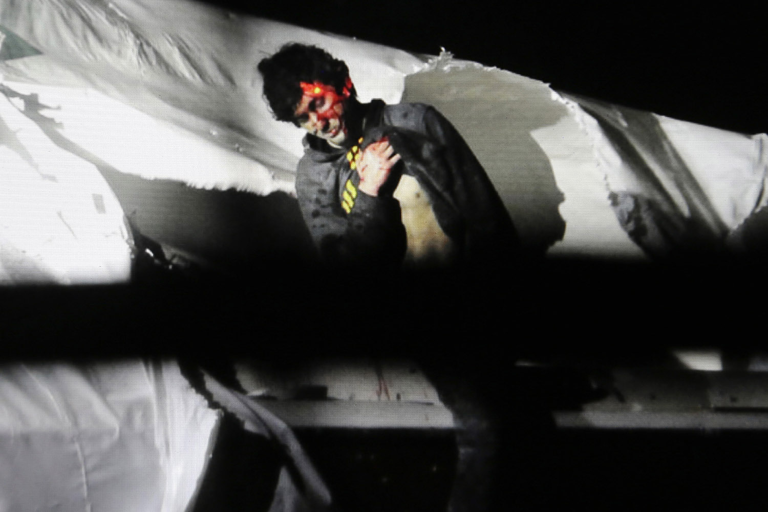 April 19, 2013. This photo released by Sean Murphy of the Massachusetts State Police shows 19-year-old Boston Marathon bombing suspect Dzhokhar Tsarnaev leaning over in a boat at the time of his capture by law enforcement authorities in Watertown, Mass.