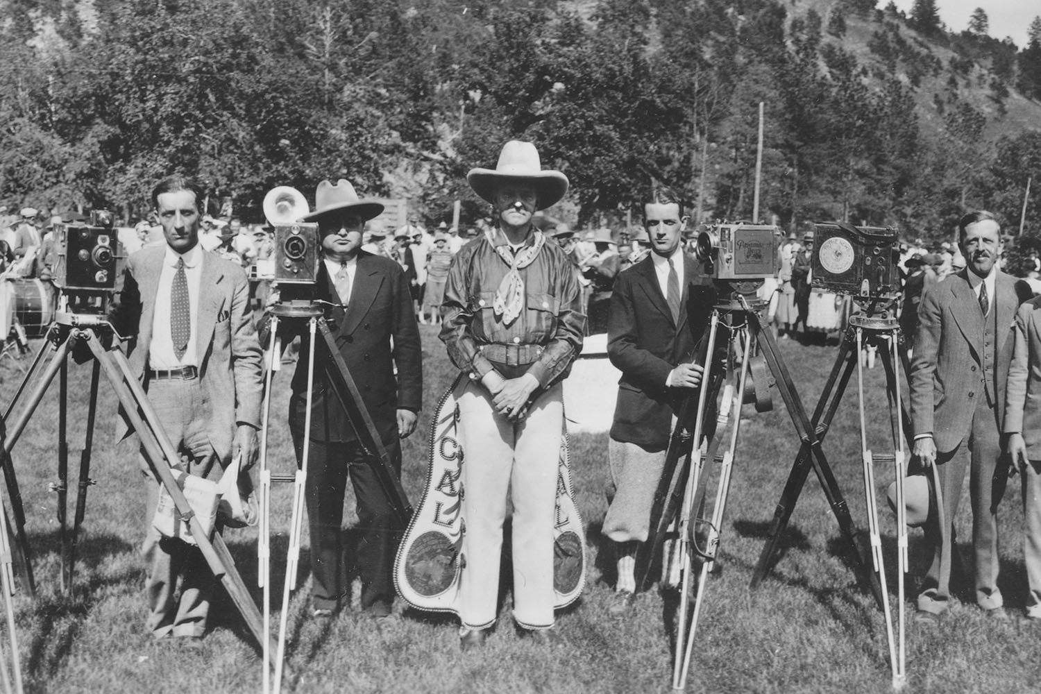 President Calvin Coolidge, clad in cowboy attire, poses with photographers while celebrating the Fourth of July in Rapid City, North Dakota, July 4, 1927.