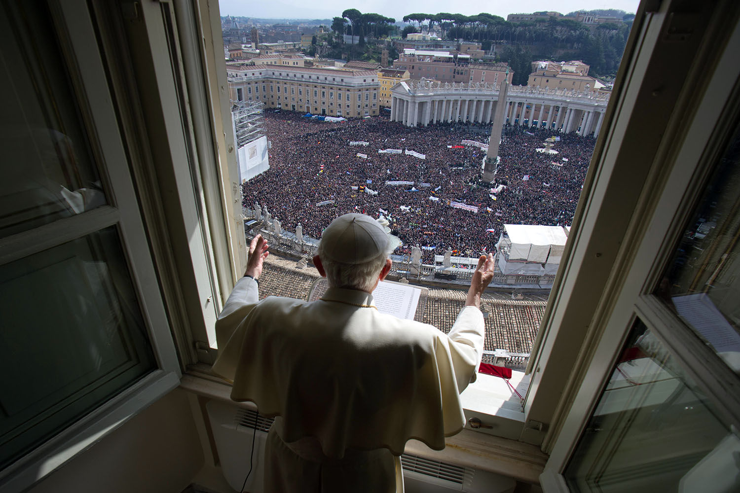 Feb. 24, 2013. In this photo provided by the Vatican newspaper L'Osservatore Romano, Pope Benedict XVI delivers his blessing during his last Angelus noon prayer from the window of his studio overlooking St. Peter's Square.