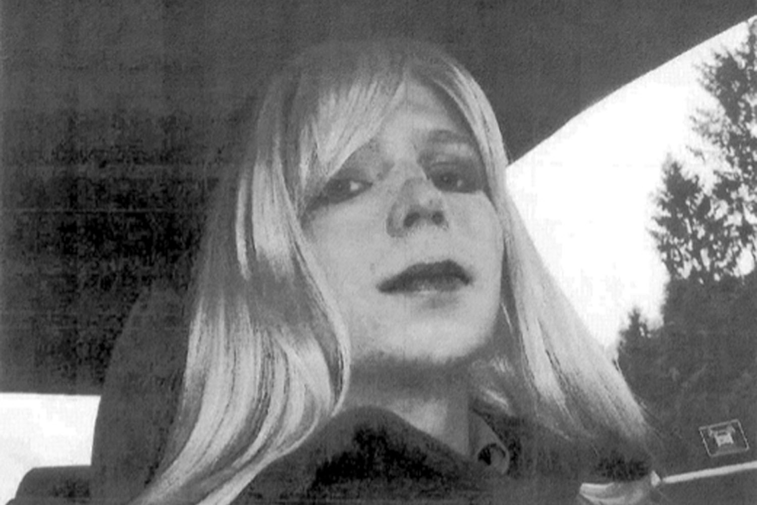 Undated. This photo provided by the U.S. Army shows Pfc. Bradley Manning posing for a picture wearing a wig and lipstick.