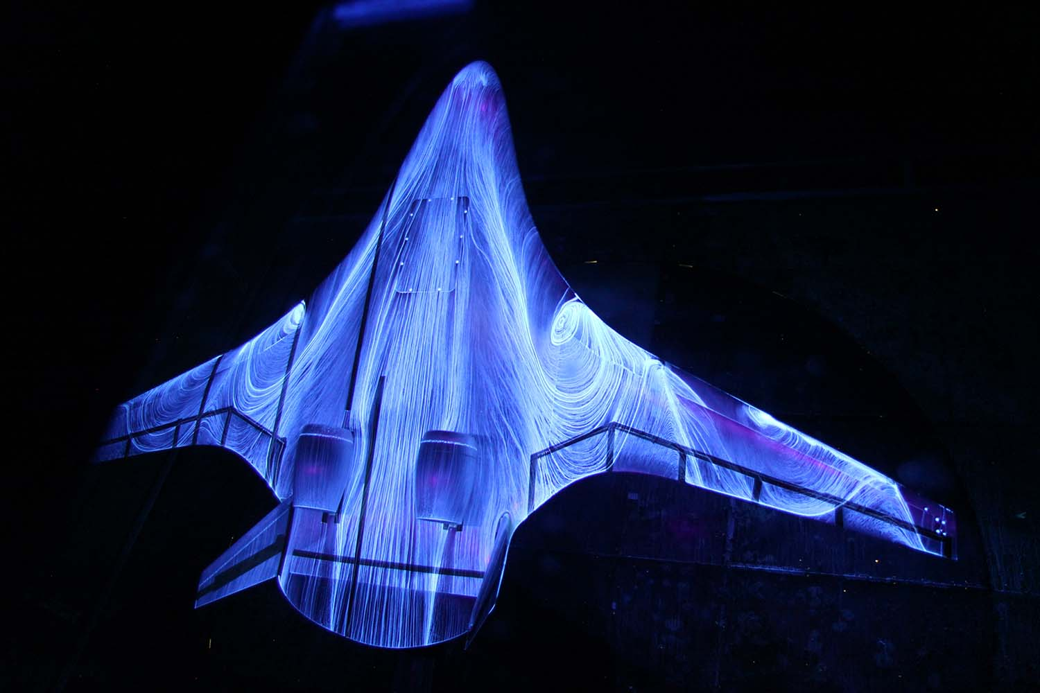 Undated. This photo provided by NASA on Sept. 27, 2013 shows fluorescent oil on a 5.8 percent scale model of a hybrid wing body aircraft during tests in the 14 by 22 Foot Subsonic Wind Tunnel at the NASA Langley facility in Hampton, Va.