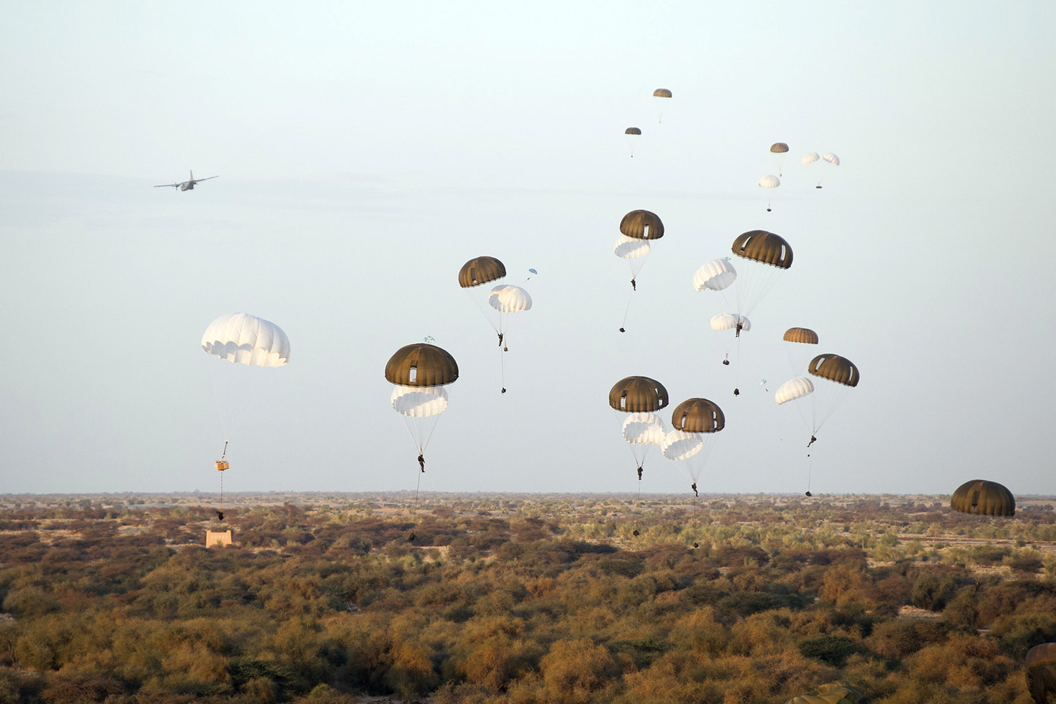 Jan. 29, 2013. In this photo provided by the French Army Communications Audiovisual office (ECPAD) on Feb. 1, 2013, French paratroopers drop from a plane over Timbuktu airport as part of the Operation Serval in Mali.