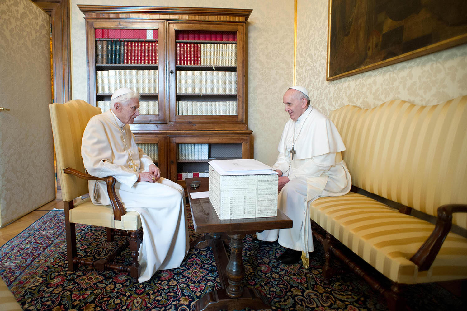 March 23, 2013. In this photo provided by the Vatican newspaper L'Osservatore Romano, Pope Francis, right, and Pope emeritus Benedict XVI meet in Castel Gandolfo.