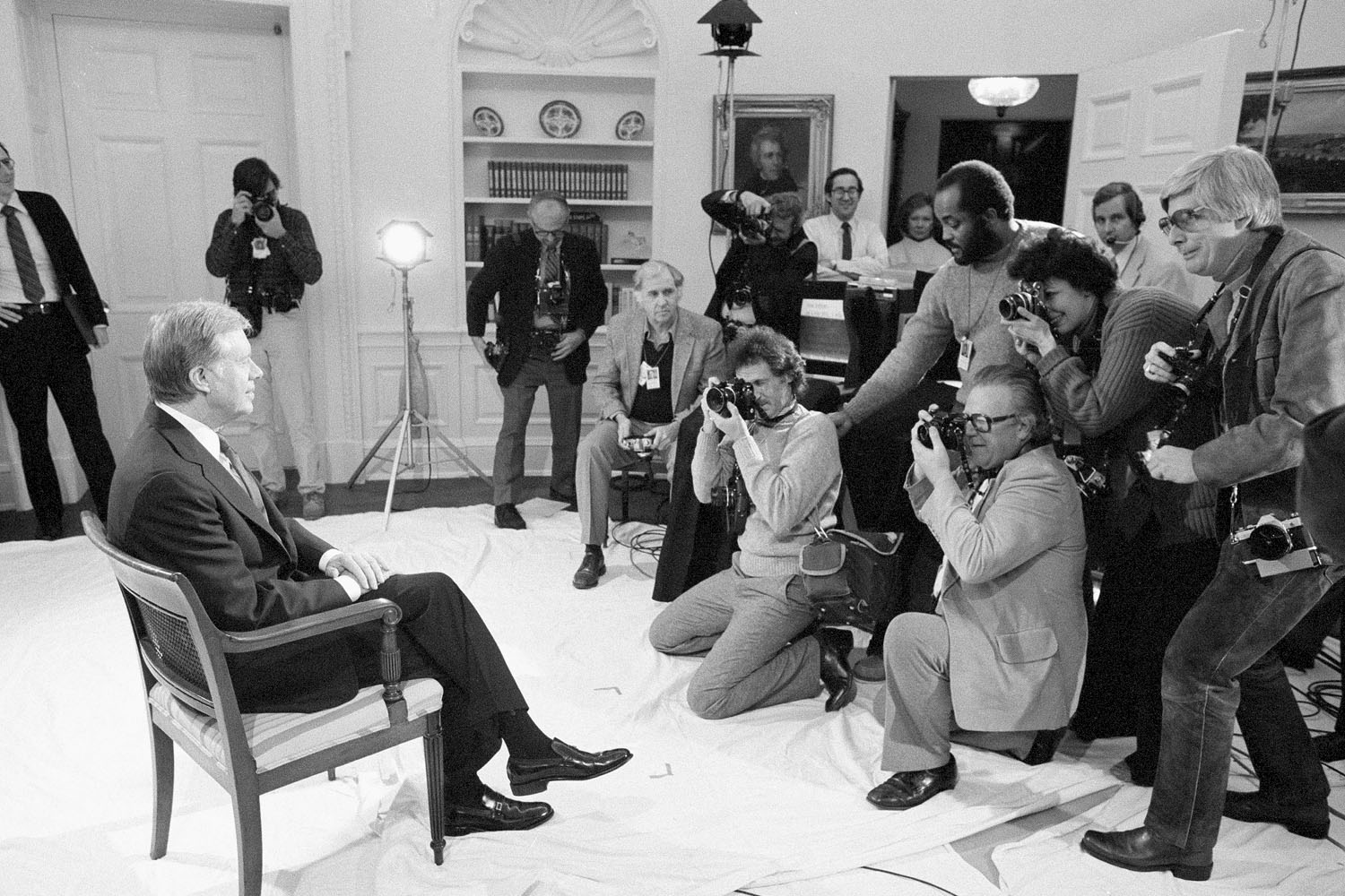 President Jimmy Carter poses for photographers in the White House January 14, 1981, just prior to delivering his farewell address on national television.