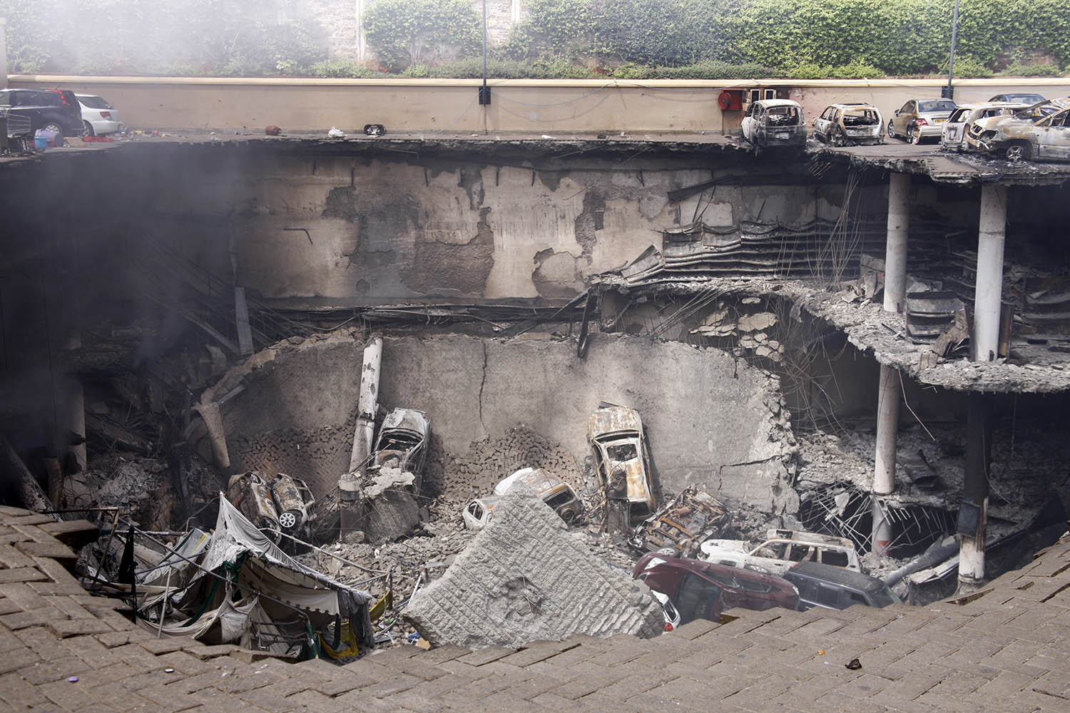Sept. 26, 2013. This photo released by the Kenya Presidency shows the collapsed upper car park of the Westgate Mall in Nairobi, Kenya.