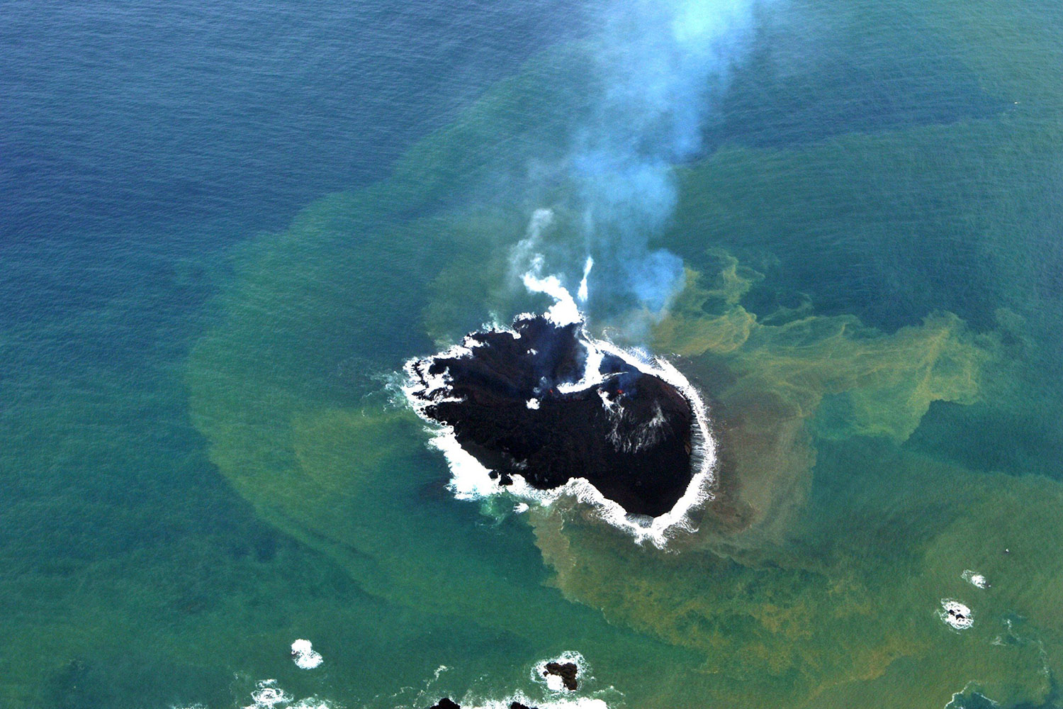 Dec. 1, 2013. This photo provided by the Japan Coast Guard shows a newly created small islet near the Nishinoshima island of the Ogasawara island chain, south of Tokyo.