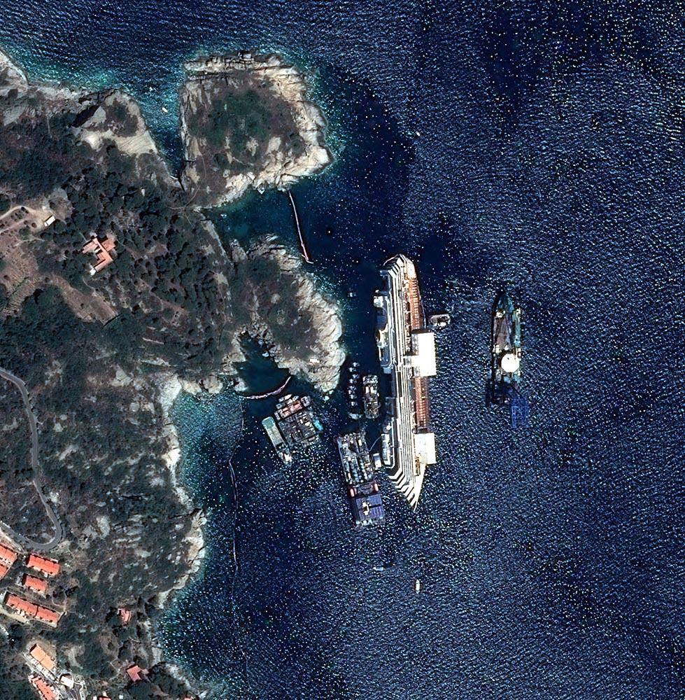 Sept. 12, 2013. This photo provided by National Center for Space Studies (CNES) shows a view of the wreck of the Costa Concordia cruise ship in the harbor of Isola de Giglio taken by the Astrium satellite.
